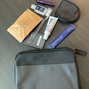 Tumi Travel Bag with travel essentials ✈️